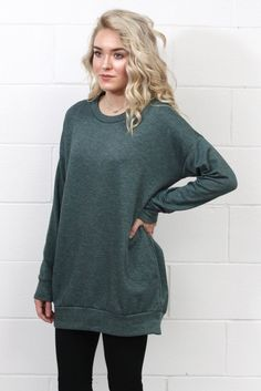 OMG...the most comfy tunic ever! This ultra soft sweatshirt tunic features a fleece interior lining and hidden side pockets. The perfect length for leggings too!
