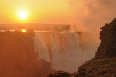 Victoria Falls at sunset.Victoria Falls makes a great addition to your Botswana Safari too! Hotel Victoria, Victoria Falls, Hotel Deals, Niagara Falls, Safari, Places To Go, Wildlife, Traveling, Africa