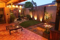 Old town Huntington Beach backyard /patio evening. Like the simple fire pit idea. Easy landscaping project.