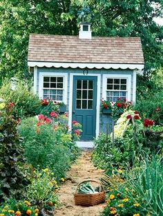 Inspiration for our Well House.  I like the weathervane, window boxes, flowers, everything... even the horseshoe above the door.
