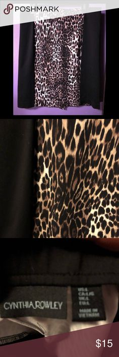 Cynthia Rowley leopard print skirt EUC Cynthia Rowley leopard print skirt with black on the sides to give u a super slimming look ! I love this skirt with a black turtle neck and boots never goes out of date! Classic look! Cynthia Rowley Skirts Midi