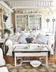 ♕ Michelle Joy's home ~ love the pillow mix on her white sofa, and that painted hutch in the back
