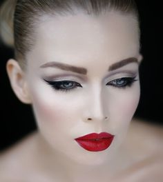 Red lipstick and cat's eye makeup #glamour #beauty #lipstick