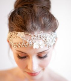 An embellished headband and high bun is elegant and unfussy