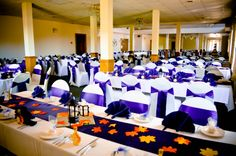 Ivory Spandex Chair Covers, Navy Blue Satin Sashes & Table Runners