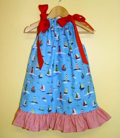Perfect for summer, this tie neck sundress is made with our turquoise sailboats fabric and features red ribbon ties and a ruffle at hem. Ribbon ties make the fit adjustable. Sizes: 12m, 18m, 2, 3 & 4. Was: $42 Now: $28. On sale now at facebook.com/jdoriginals