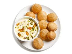 Shrikhand and Pooris: Try this recipe from Aarti Sequeira's mom who serves Pooris with a vanilla yogurt pudding called shrikhand. A bit of the two together tastes like a cream-filled doughnut.