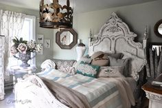 Elaborate white headboard  / 9 - A tour of Lucketts Design House via http://www.funkyjunkinteriors.net/
