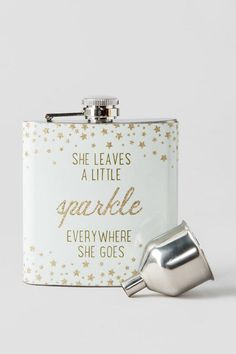 """""""She Leaves a Little<strong>Sparkle</strong>Everywhere She Goes""""<br /> <br /> This girly flask will be the perfect addition to your girls night out or a bachelorette party!<br /> <br /> - 3.5"""" x 3.75""""<br /> - 6 oz. (170 ml)<br /> - Stainless steel<br /> - Hand wash only<br /> - Not dishwasher, freezer, or microwave safe<br /> - Attached twist top with funnel<br /> - By Natural Life<br /> - Imported<br />"""