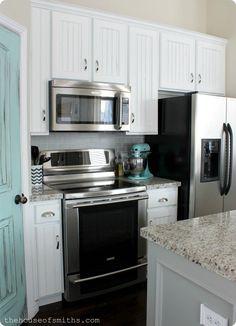 A Kitchen Re-Style: Part 4 - Cabinets & Backsplash Giallo Ornamental granite and white cabinets
