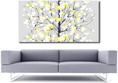 I love this artwork (and the sofa too). For my yellow and grey bedroom. I wonder how much shipping from UK is?
