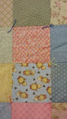 Basic patchwork quilt tied with various colors of embroidery floss.