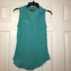 Teal shirt Shirt sleeves shirt with a pocket. The material is thick and soft. Almost Famous Tops Blouses