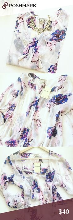 """HPNWT Lucky Brand Floral Blouse Gorgeous purple and blue floral split neck blouse with tassels from Lucky Brand! Brand new and never worn! Effortless,light,airy,and beautiful to wear with a cami underneath and white shorts or pants! Size M,100% polyester. Length approx 24"""",armpit to armpit approx 20"""". Chosen as a Host Pick by @susanlee321 for Top Trends Party! Lucky Brand Tops Blouses"""