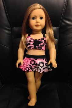 Cute pink cheetah print swimsuit by AnnalisesArmoire. Made with the Making Waves Swimsuit pattern, found at http://www.pixiefaire.com/products/making-waves-swimsuit-18-doll-clothes. #pixiefaire #makingwavesswimsuit