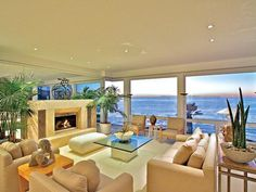 I love the contemporary feel of this room!  I also love the view of the ocean!