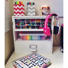My desk set-up! Pens, markers, highlighters, washi tape, and my Erin Condren life planner. :)