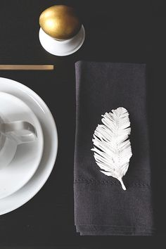 Feathers have caught on a little here in the States, but we're excited to see a full-blown feather epidemic, as seen in this Swedish Easter tablescape. (But let's go with fake feathers, okay?)   - ELLEDecor.com