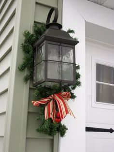 Simple idea to dress up outdoor light fixtures. Christmas Time Is Here, Merry Christmas, Christmas Porch, Outdoor Christmas Decorations, Christmas Holidays, Christmas Crafts, Christmas Outdoor Lights, Christmas Lanterns, Light Decorations