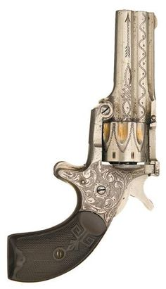 Factory engraved Osgood Gun Works Duplex revolver. Features a .22 caliber, eight shot cylinder and a .32 caliber rimfire single shot center barrel which also acts as the cylinder pin. ~1880