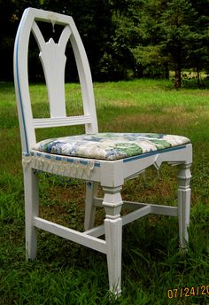 Shabby chic chair in blue.  Trimmed with satin ribbon, lace and blue glass beads wrapped in silver wire.  For sale at $89.