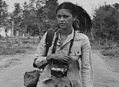 """""""Françoise Demulder was a French war photographer who in 1976 became the first woman to win the prestigious World Press Photo of the Year award. The winning image was a black-and-white photo of a Palestinian woman raising her hands at a masked militiaman in Beirut's war-ravaged La Quarantaine district. Demulder died on 3 September 2008 aged 61, having suffered a heart attack at a hospital in the Paris suburb of Levallois-Perret."""""""