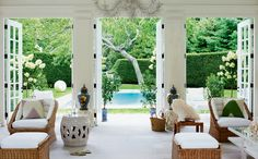 "Indoor/Outdoor living is essential in the Hamptons. Large windows and french doors help bring the outdoors inside. ""Aerin Lauder's Book, Beauty at Home, Showcases Her Passion For Interior Design : Architectural Digest"" Indoor Outdoor Living, Outdoor Rooms, Outdoor Furniture Sets, Cane Furniture, Outdoor Kitchens, Wicker Furniture, Die Hamptons, Interior Exterior, Interior Design"
