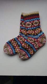 These socks are knitted with traditional Fair-Isle colours and patterns. The yarn is knit doubled to give a thicker sock and knit at quite a firm tension. Both sizes follow the same pattern but the gents version is knit on a slightly larger needle with a looser tension of 27sts & 31rs over 10cm. The socks are knit from the cuff down with an afterthought heel which is knit the same as the toe. The yarn is worsted spun so has a very smooth soft handle. There are 6 different colours of which...