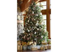 Love the look of this Christmas tree.  Think I am going for ivory, silver, kraft and gold this year.  Very pretty.