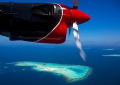 Maldivian Air Taxi Seaplane Flying Over An Atoll, Male, Maldives, via Flickr.