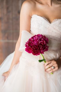 large magenta flower // photo by Michelle Boyd Photography // styling by Sweet Sunday Events // View more: http://ruffledblog.com/tying-the-knot-wedding-inspiration/