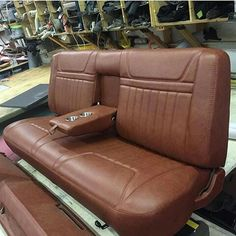 Truck bench seat with fold down armrests