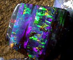 Boulder Opal This dark opal is found in Western Queensland and it forms naturally on its host rock of ironstone, which is cut to form part of the gemstone. Boulder Opal occurs as thin veins in sedimentary ironstone boulders. The colour layer is naturally Minerals And Gemstones, Rocks And Minerals, We Will Rock You, Beautiful Rocks, Mineral Stone, Rocks And Gems, Opal Jewelry, Stones And Crystals, Gem Stones