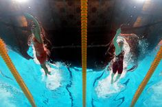 (L-R) Ranomi Kromowidjojo  and Camille Muffat  compete during the Swimming Women's 100m Freestyle preliminaries heat seven.