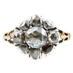 Georgian Rose Cut Diamond Gold Cluster Ring. 18th Century rose cut diamond ring. Very fine example in silver on gold with detailed back and finely foil backed rose cut stones. Circa 1780. English in origin.
