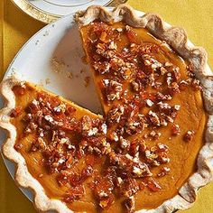 A swirl of maple syrup turns this classic pumpkin pie into a holiday favorite. Crunchy pieces of homemade salted pecan brittle finish the dessert.
