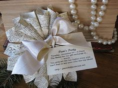 unique invite made from dictionary-paper cones, finished with a satin bow.