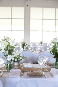 Green & white flowers combo with heshen table runners & menus looks beautiful and classic.  Read more - http://www.stylemepretty.com/australia-weddings/2013/05/18/style-me-pretty-australia-welcomes-our-advertisers-giveaways/
