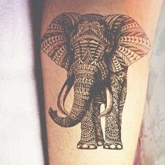 The detail on this black ink elephant is amazing.  Would love a tat with this element of design!