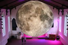 luke jerram's touring art installation is lit from within, illuminating hyper-detailed NASA imagery sourced from the lunar surface.