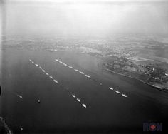 Aerial view of RCN ships dressed in Halifax Harbour for Her Majesty Queen Elizabeth II. Ceremony,Ships Formation