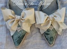 Another tutorial on how to turn modern shoes into 18th century mules.   http://www.decortoadore.net/2013/10/creating-18th-century-styled-shoes-and.html