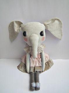 Love her little dress!  Beautiful dolls by clothandthread.com