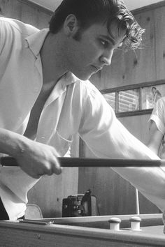 Elvis Presley playing pool in his Audubon Drive home, May 1956. Photo by Phillip Harrington.