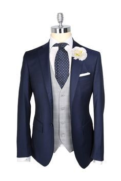 Navy blazer + gray vest + navy patterned tie...this is so sharp