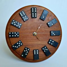 Create a quirky wall clock that is full of personality using a thrifted cutting board and some antique / vintage dominoes.