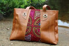 Discover unique handmade leather handbags with Mola fabrics on Seal of zAz. A perfect blend of leather and multi-coloured Mola for a one-of-a-kind bag. Unique Bags, Leather Handbags, Handmade, Leather Purses, Craft, Leather Bags, Arm Work, Hand Made