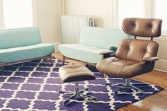 LOVE the purple trellis rug with mint green couches - who would have thought that color combination worked?