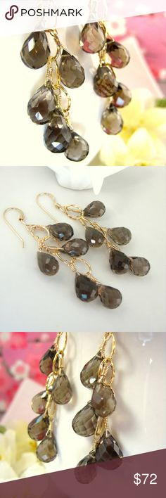 Smokey quartz drop gold hoop dangle earrings This is an elegant pair of smokey quartz drop gold hoop dangle earrings that are simply gorgeous and vibrant the eye. They are delicately made with loving care. The AAA micro-faceted smokey quartz tear drop briolettes are high quality precious stones that dangle off a gold-filled hoop hammered chain. They are transparent brown and very sparkly high quality precious stones. There are 4 gold hammered hoops linked together with 5 smokey quartz…
