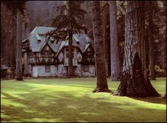"""One of the medieval-style cottages of William Randolph Hearst's Wyntoon, still owned by the Hearst family, in Siskiyou, California.  The only way to get a glimpse of Hearst's Bavarian """"village"""" is by kayak, and traveling through dangerous rapids.  (Gill & Witney, 1978)"""
